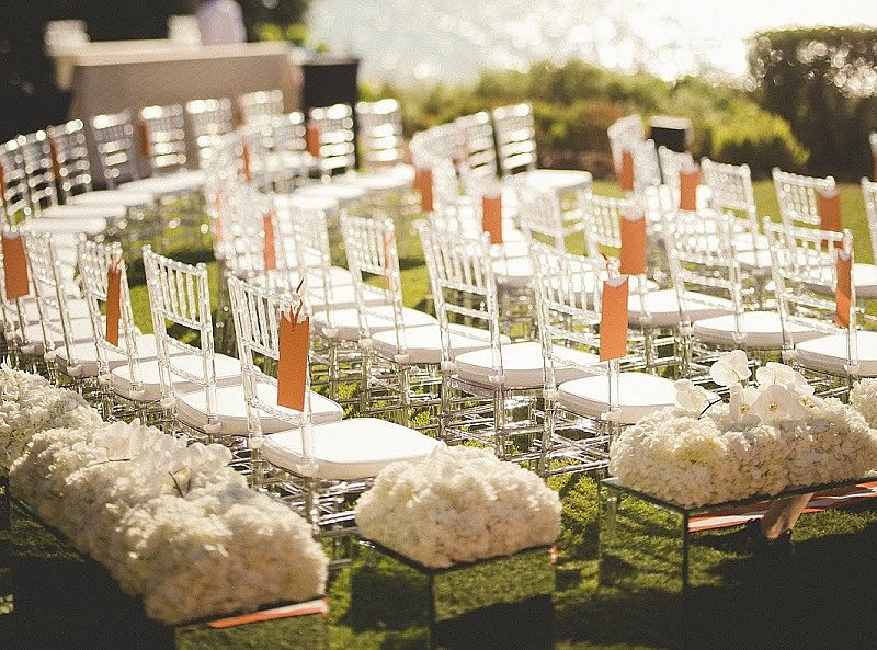 Our Clear Chiavari Chairs With White Padded Seating At An Outdoor Wedding